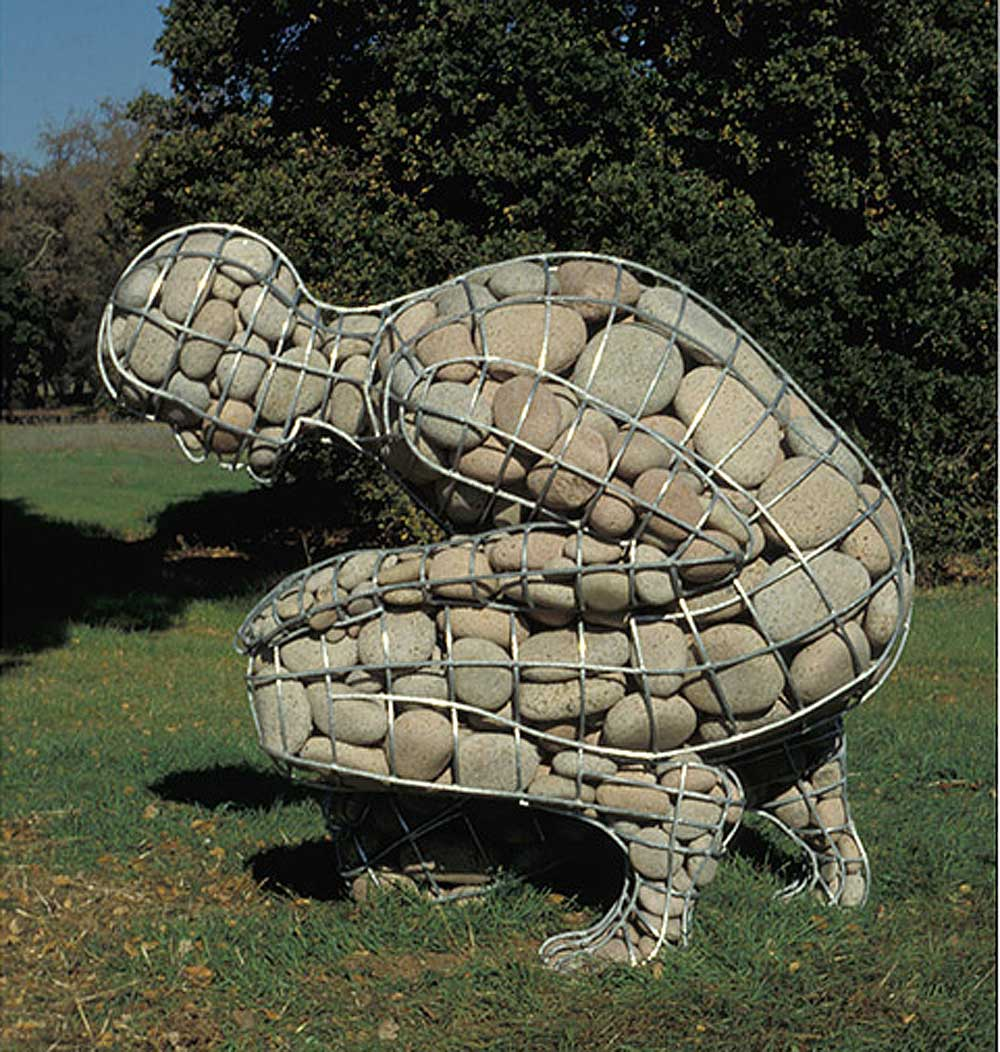 """<em>Rising Cairn</em>, by <a href=""""http://www.celesteroberge.com/w-cairn-rising.php"""">Celeste Roberge</a>. Welded galvanized steel and granite, 58"""" x 54"""" x 43"""". Collection: Runnymede Sculpture Farm, Woodside, California."""